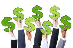 Diverse Business People Holding Dollar Sign Stock Images
