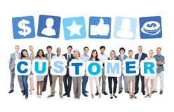Diverse Business People Holding Word Customer Royalty Free Stock Photography