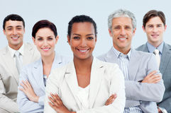 Diverse business people standing with folded arms stock images