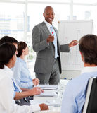 Diverse business people studying a business plan Royalty Free Stock Image