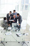Diverse business people studying a sales report Stock Photography