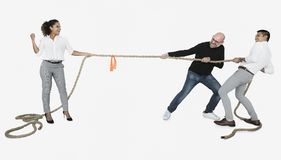 Diverse business people tugging on a rope stock images