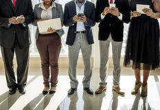 Diverse Business People Use Digital Devices royalty free stock image