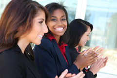 Diverse Business Team Clapping. A diverse business woman team clapping at presentation Stock Image