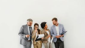 Cheerful diverse business team discussing work royalty free stock images