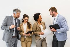 Diverse business team discussing work in their office stock image