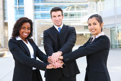 Diverse  Business Team (Focus on Man). A diverse attractive man and woman business team at office building (Focus on Man Royalty Free Stock Photos