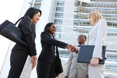 Diverse Business Team Handshake Stock Images