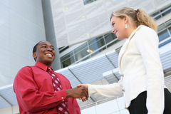 Diverse Business Team Handshake. An attractive, diverse business team shaking hands at office building Royalty Free Stock Photo