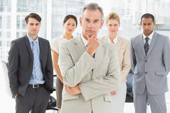 Diverse business team looking at camera Stock Photo