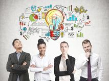 Diverse business team members, business plan Stock Image