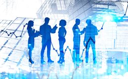 Diverse business team in modern city, stock market. Diverse business team members silhouettes working with documents and talking over abstract city background stock image