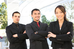 Diverse Business Team at Office Building. An attractive, diverse business team at office building Royalty Free Stock Photo