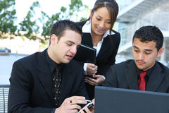 Diverse Business Team at Office Building. An attractive, diverse business team at office building Stock Images