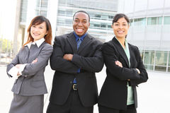 Diverse Business Team at Office Building. An attractive team of diverse business people at company office building Stock Image