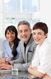 A diverse business team sitting in a row stock photos