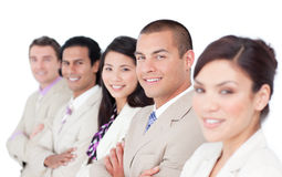 A diverse business team standing in a line. Against a white background Royalty Free Stock Photography