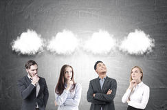 Diverse business team, thought clouds, blackboard Stock Photos