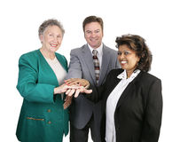 Diverse Business Team - Unity. A diverse business team putting their hands together in a show of unity Stock Image