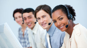 A diverse business team working in a call center. With headset on Stock Photo