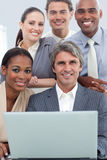 A diverse business team working at a laptop. In a meeting Stock Photos