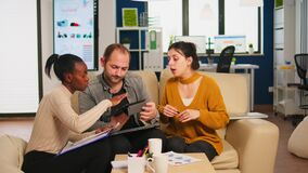 Diverse businesspeople analysing financial project during corporate meeting