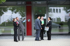 Diverse businesspeople chatting outdoors Stock Images