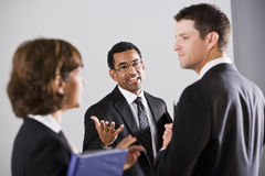 Diverse businesspeople conversing Stock Image