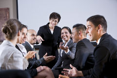Diverse businesspeople conversing, woman at front royalty free stock photography