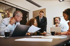 Diverse businesspeople at work together in an office boardroom stock photo