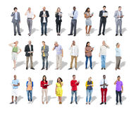 Diverse Casual and Business People Using Digital Devices Royalty Free Stock Photography
