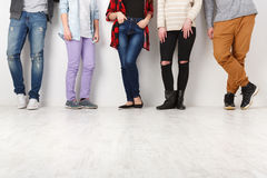 Diverse casual people standing in row indoor, crop. Casual young people. Crop of diverse informal students standing in row indoors on white studio background royalty free stock images