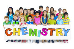 Diverse Cheerful Children Holding the Word Chemistry Stock Images