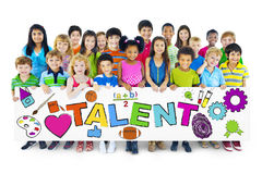 Diverse Cheerful Children Holding the Word Talent.  stock photos