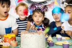 Diverse children celebrating birthday party royalty free stock photography