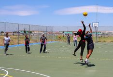 Diverse children playing Netball at school royalty free stock photo