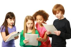 Diverse children reading stock photo