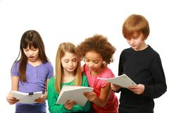 Diverse children reading. Diverse group of kids reading scripts Royalty Free Stock Photography