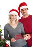 Diverse Christmas couple Stock Photos