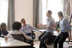 Diverse colleagues talking on business training with coach. Diverse colleagues sitting in circle, talking on business training with coach, multiracial team royalty free stock image