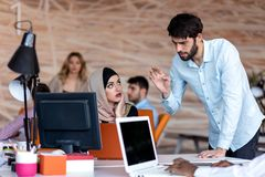 Diverse college students using laptop and talking, learning exchanging ideas stock photos