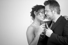 Diverse couple celebrating Royalty Free Stock Image
