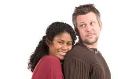 Diverse couple; she's leaning on his back Royalty Free Stock Photography