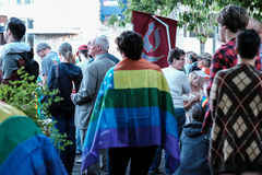 Diverse crowd gathers for Oregon vigil honoring Orlando victims. Corvallis, Oregon: Diverse crowd with banners, flags, and candles comes to vigil to honor Stock Photo
