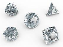 Diverse diamanten op wit Stock Foto's