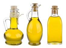 Diverse die olijfolieflessen op witte achtergrond worden geïsoleerd Stock Afbeelding