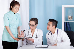 Diverse doctors doing their job Stock Photography