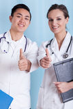 Diverse doctors with okay gesture Stock Image