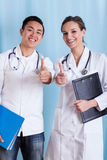 Diverse doctors showing okay gesture Stock Image