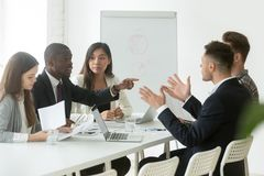 African worker disputing disagreeing with caucasian colleague du. Diverse employees arguing during team meeting, african office worker disagreeing with caucasian Stock Image